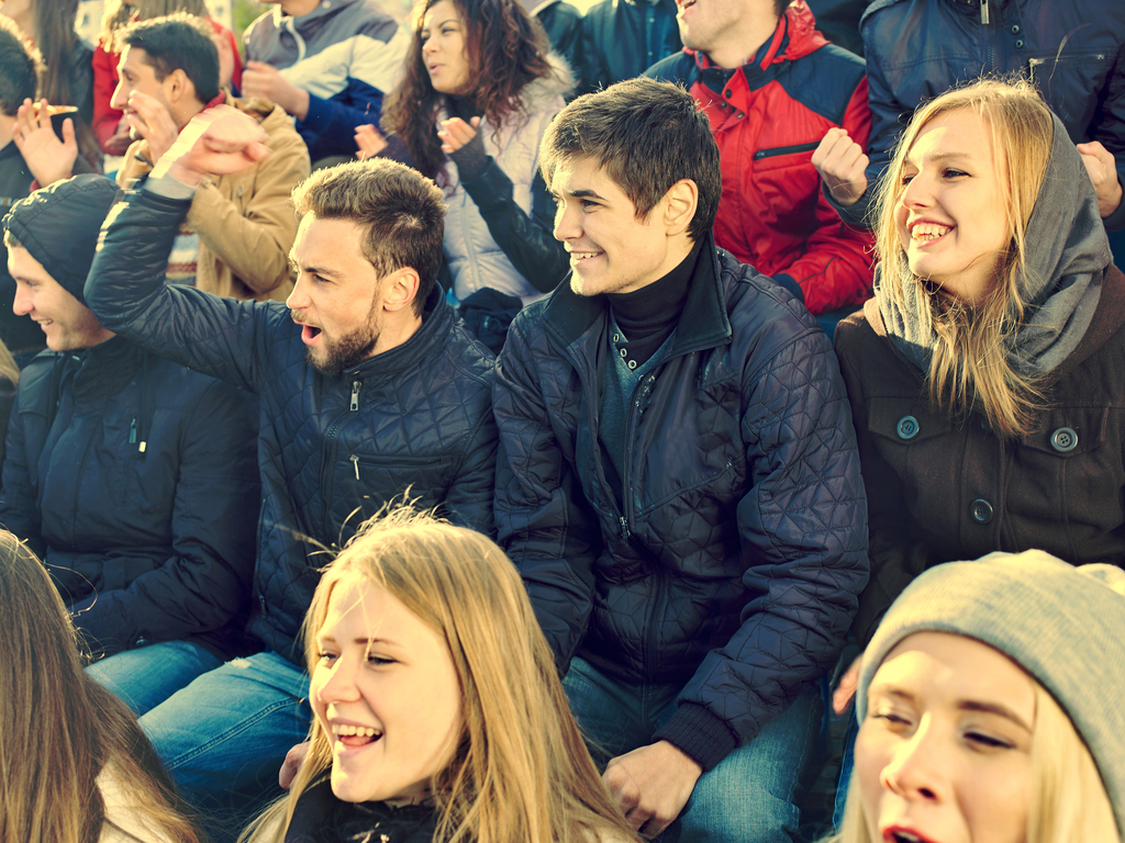 Friends at Sports Game Things No One Over 40 Should Do