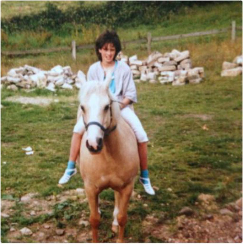 Awkward Lena Headey on a horse.