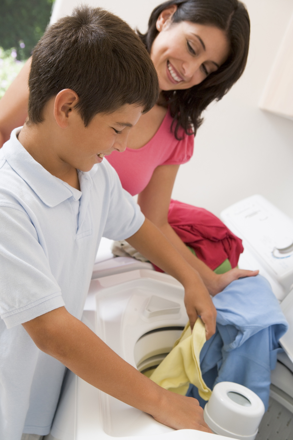 Mother and Son Doing Laundry Parenting