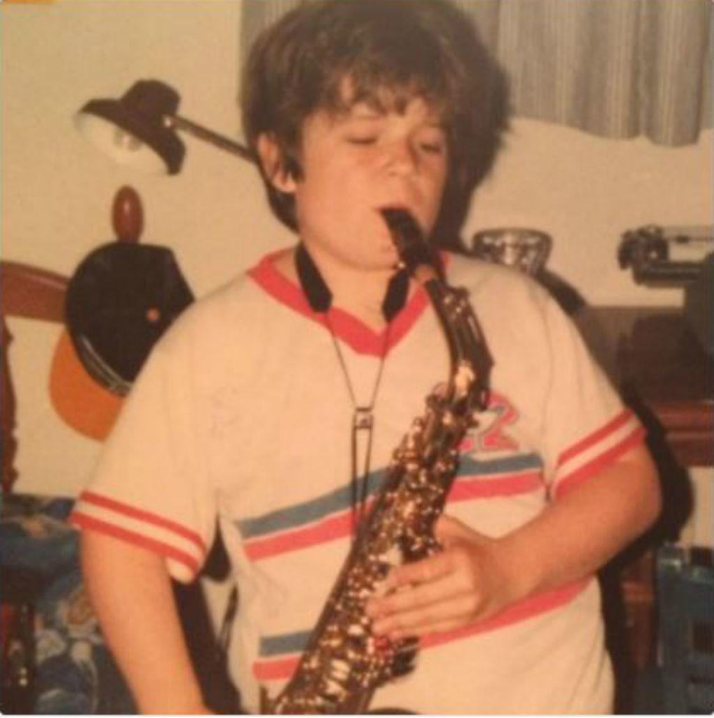 Teen Patton Oswalt playing a saxophone