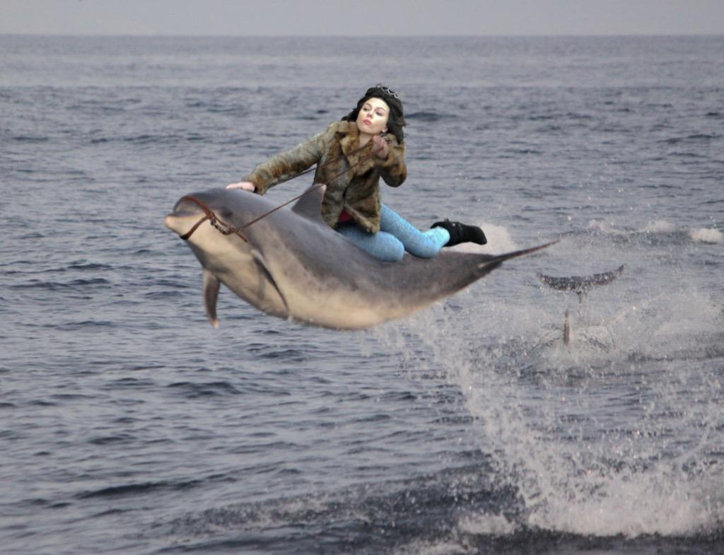 Scarlett Johansson on a dolphin