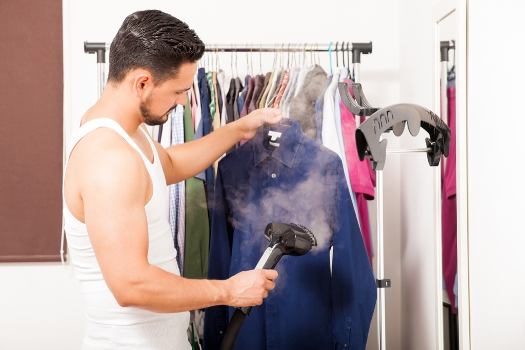 Man steaming clothes how to get rid of bed bugs