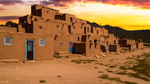 taos traditional adobe homes at sunset