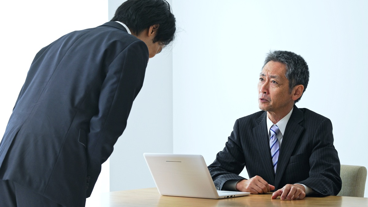 middle age man is criticized by his boss