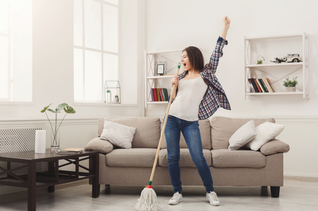 woman dancing and mopping