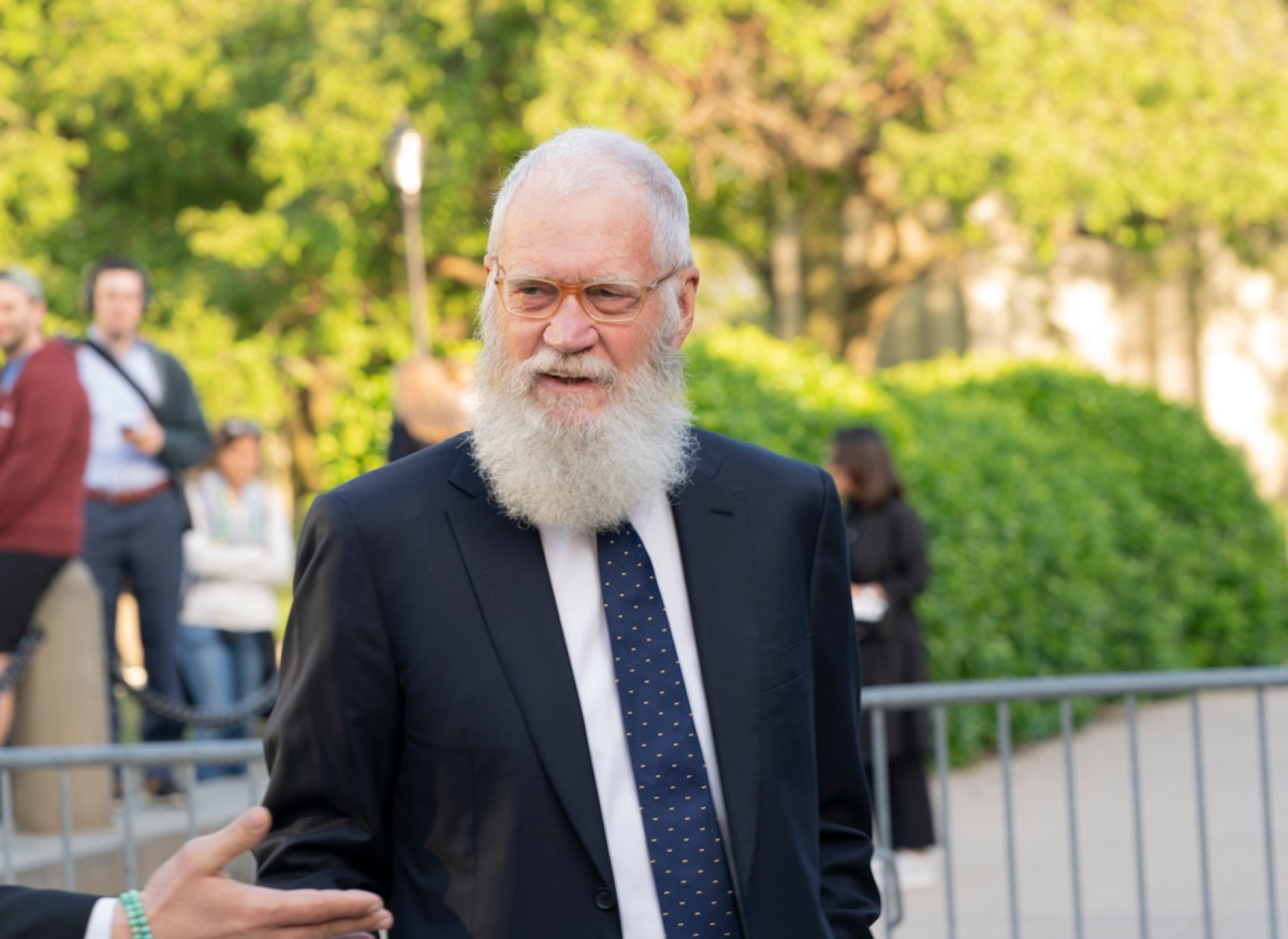 David Letterman talking outside to someone out of frame