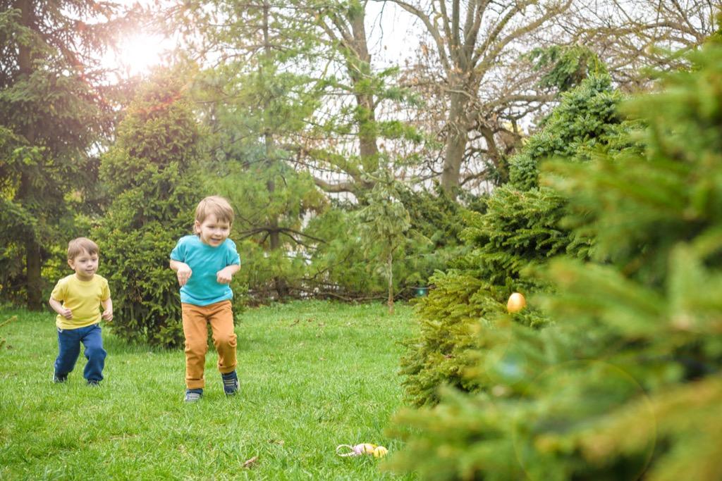 kids having an easter egg hunt outside - best easter games