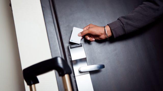 man entering hotel room