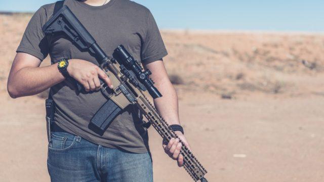 Man posing with gun