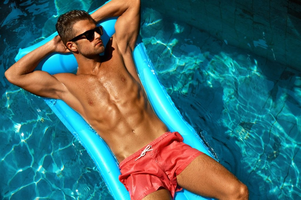 man tanning on a raft in a pool, skin cancer facts