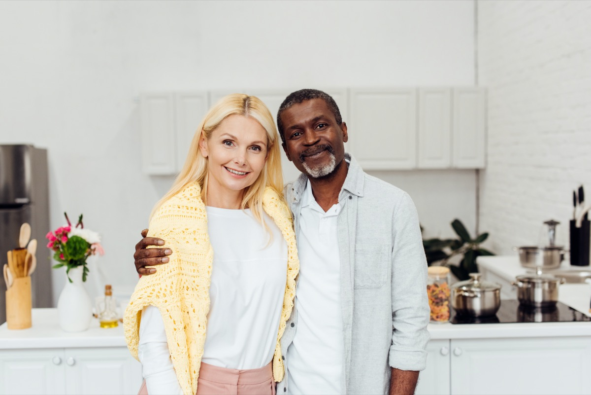 middle age interracial couple embracing
