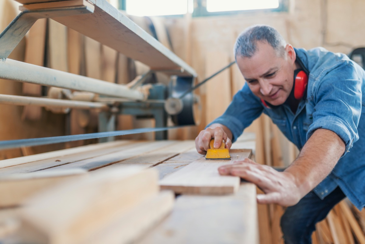 middle age man doing woodwork