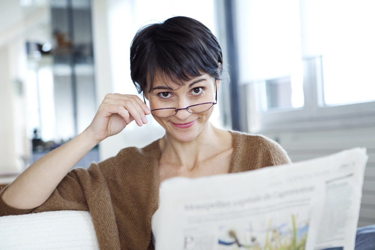 woman tilting her glasses down