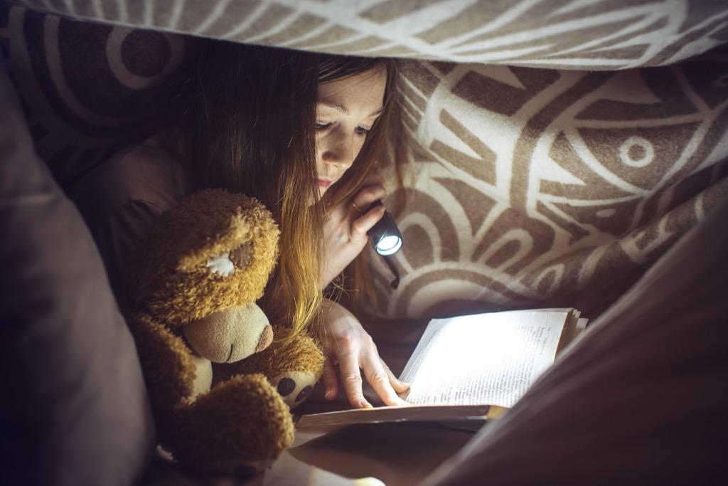 girl reading in dark Lies Kids Say