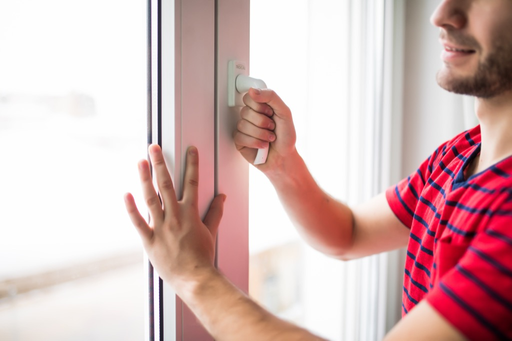 man opening window {what to do if you have the flu}