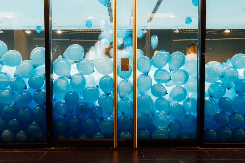 Room filled with blue ballooons