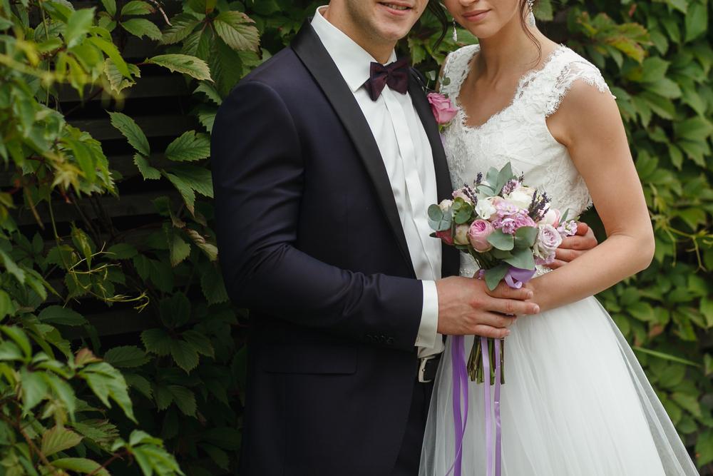 groom holding bride around waist