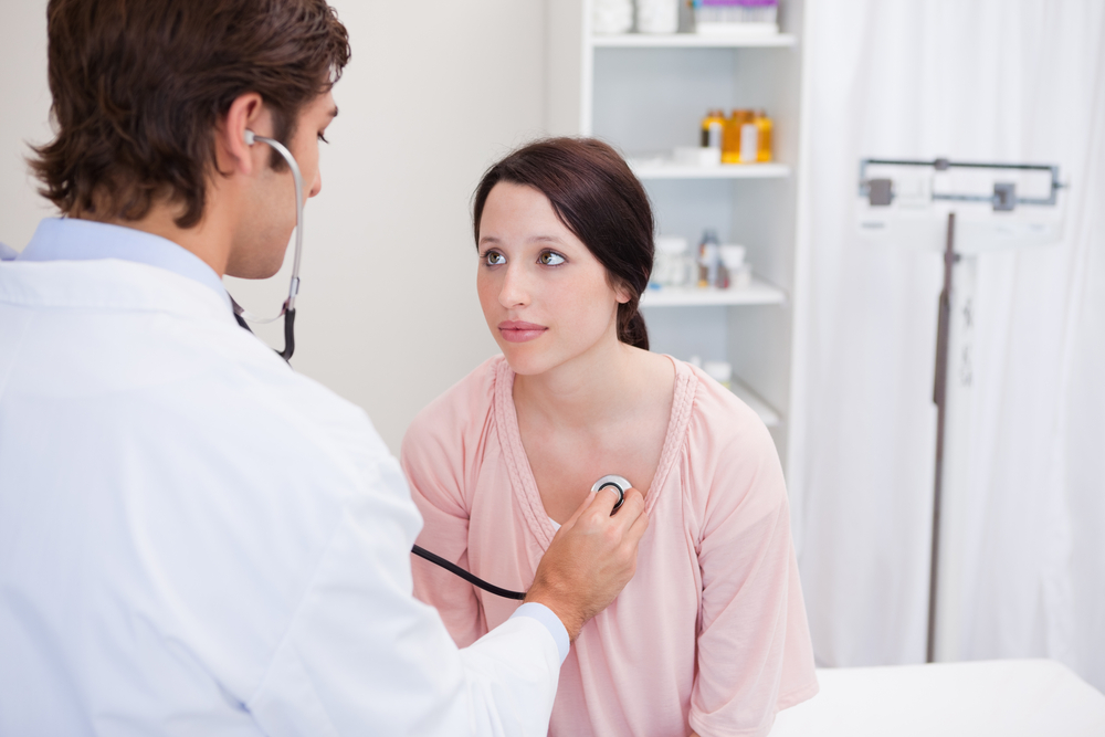 doctor checks out heart beat in women