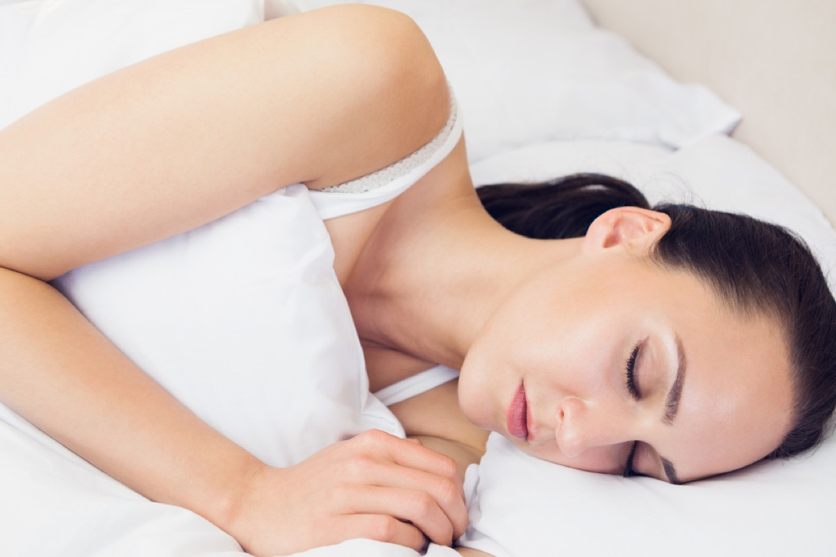 young white woman sleeping with ponytail