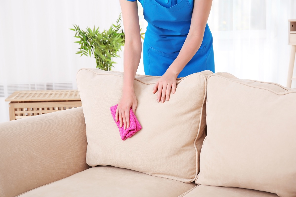 Woman Cleaning an Upholstery Stain on the Couch Cleaning Hacks