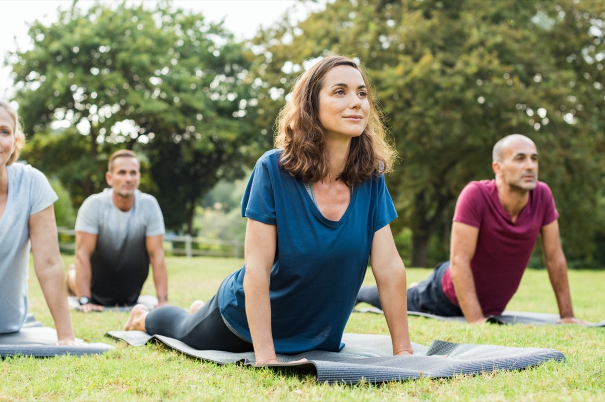 middle age caucasian woman doing yoga