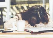 woman sleeping at desk alzheimers symptom