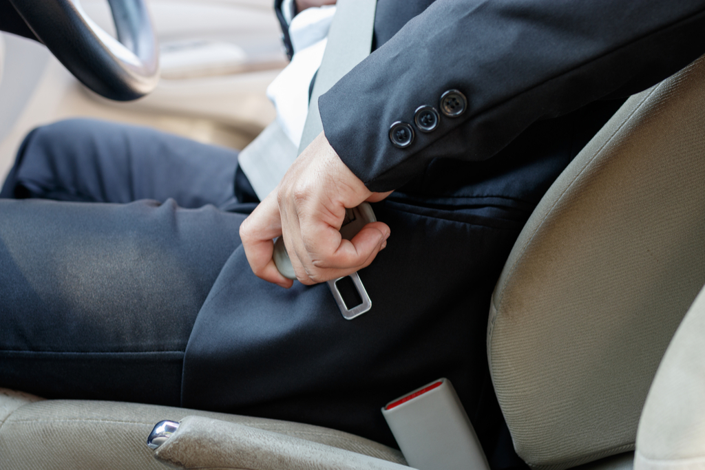 Businessman Putting on Seatbelt Illegal things