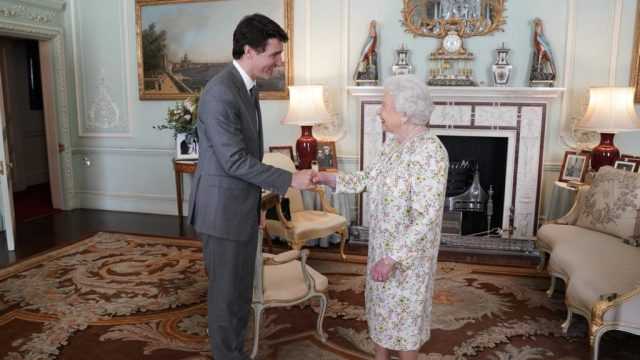 Justin Trudeau greets the Queen ahead of the Commonwealth state banquet at Buckingham Palace.