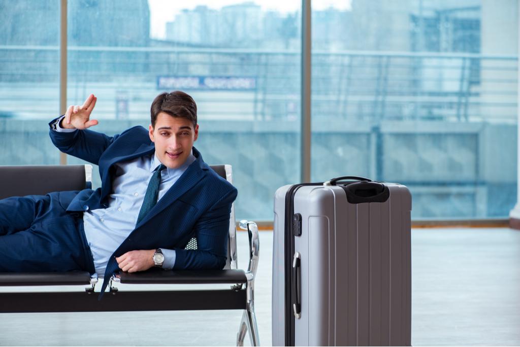 Drunk Businessman at Airport Plane