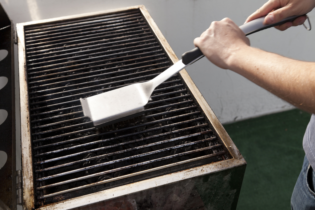 Man Cleaning Grill Summer