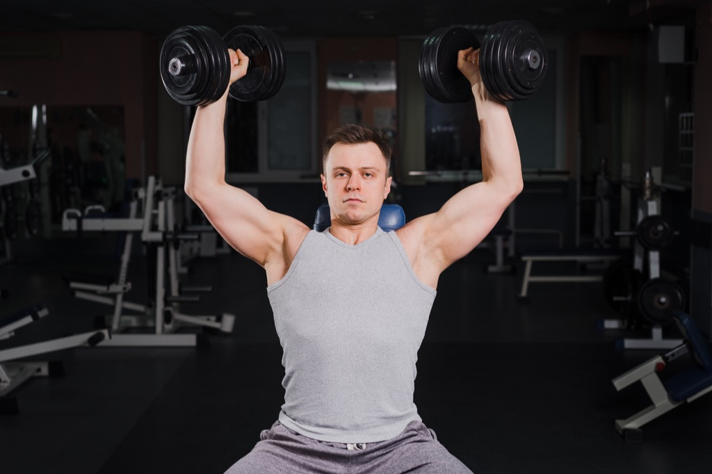 Man Lifting Weights on Bench Beach Body Tips