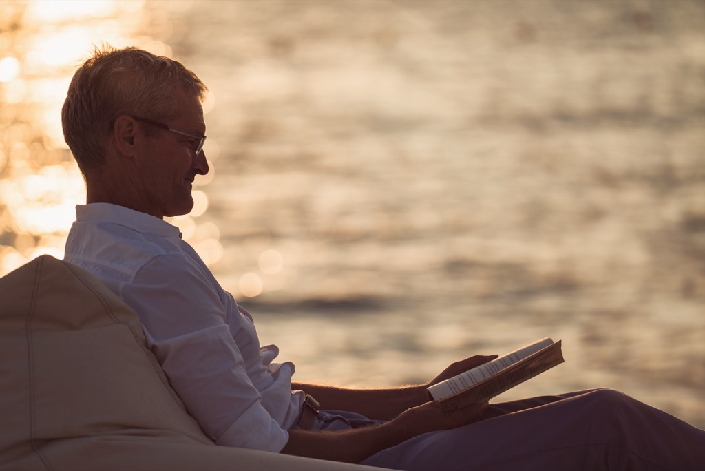 Man Reading Poems by the Ocean