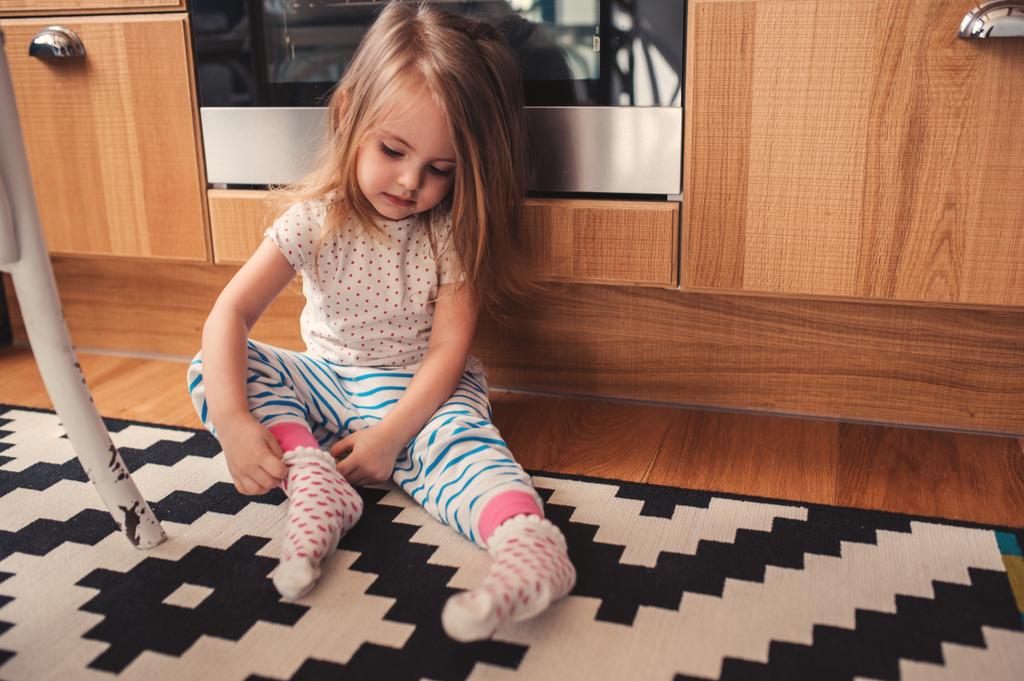 Toddler Daughter Dressing Herself