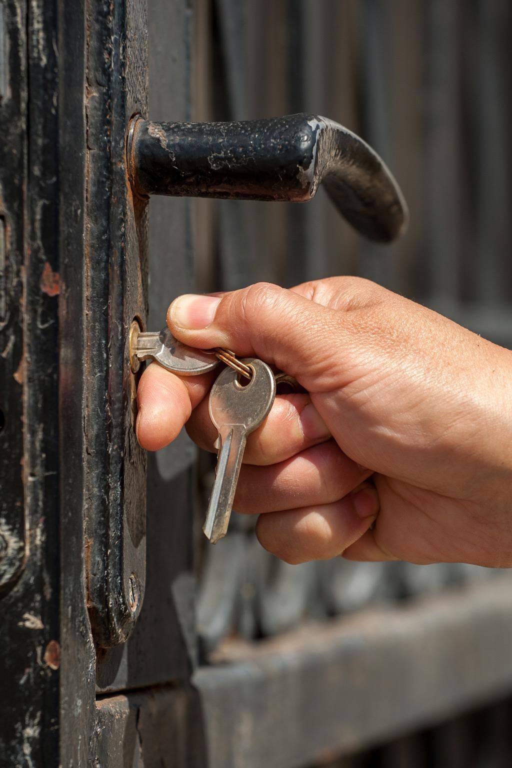 man locking door