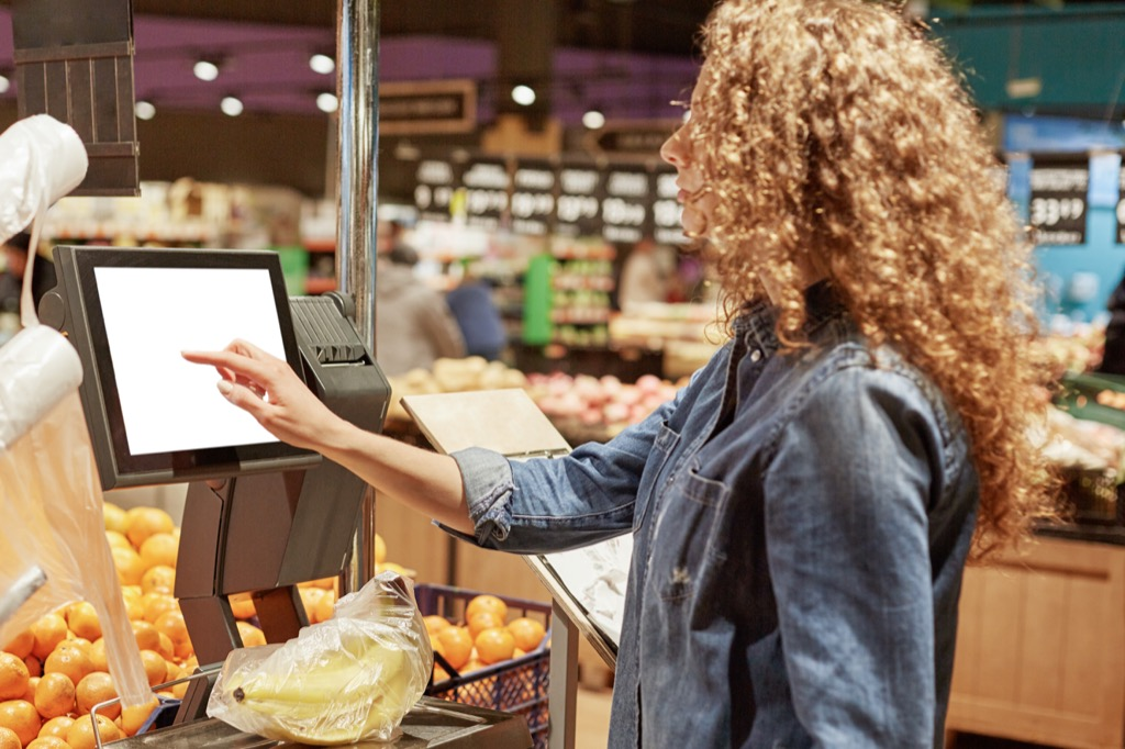 Woman Weighing Fruit Grocery Shopping Mistakes