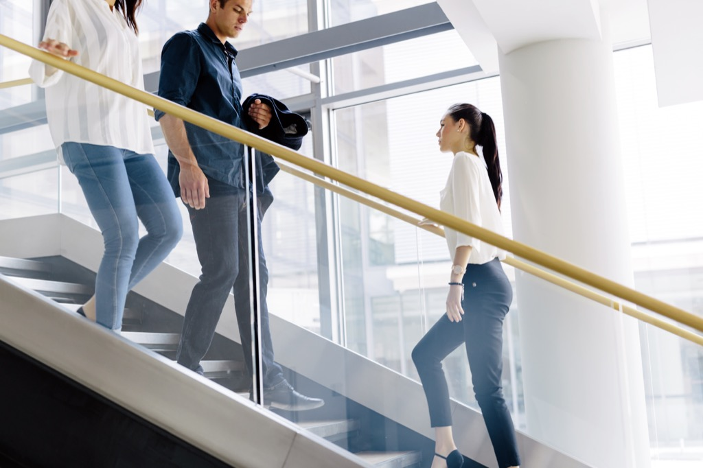 office workers taking the stairs