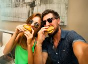 couple eating burgers