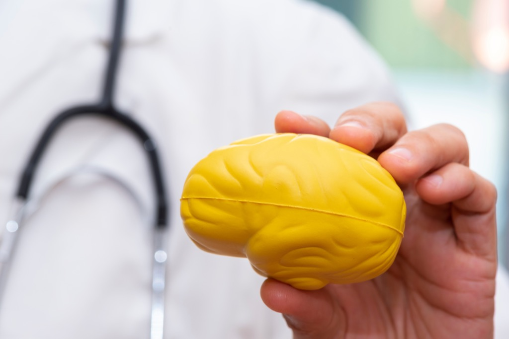 doctor holding a brain