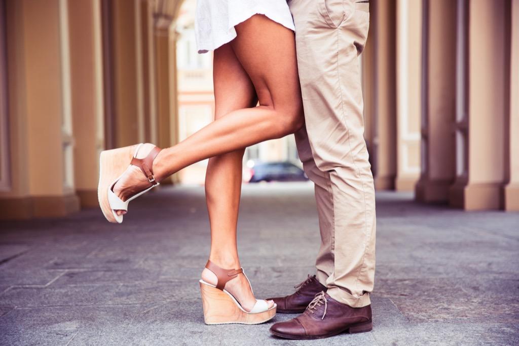 flattery woman kicking leg back