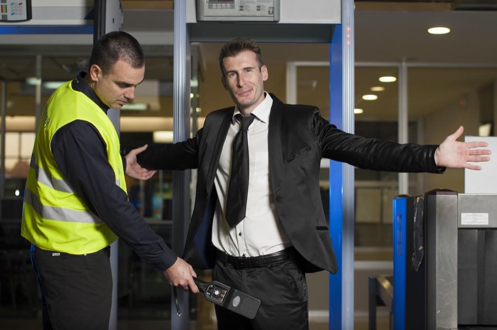 Man going through airport security