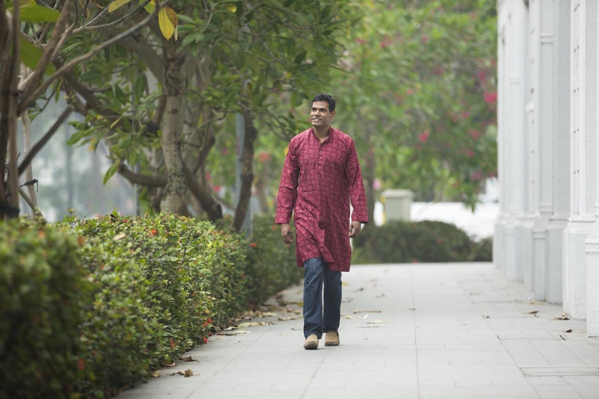 Indian man walking around outside