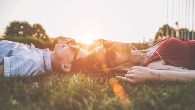 lying in grass outside daily health hacks