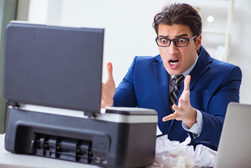man angry at printer