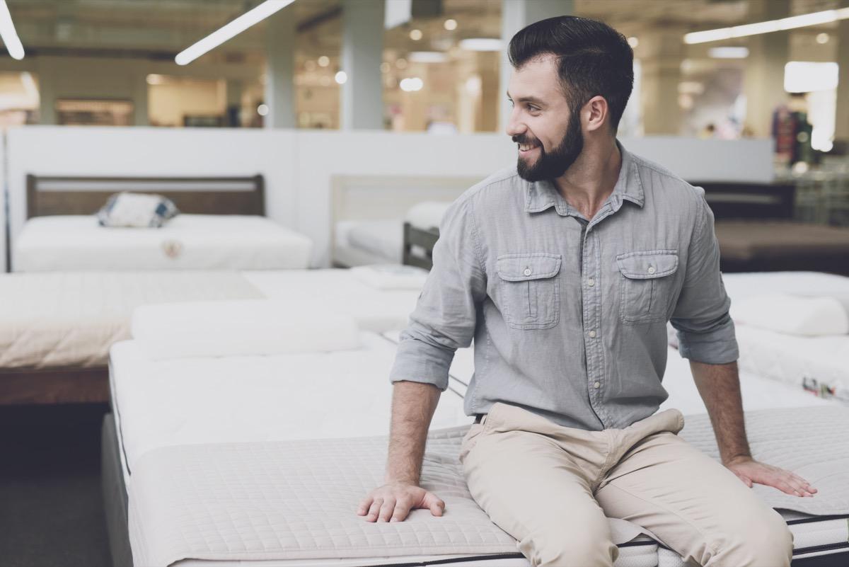 Man shopping for a new mattress
