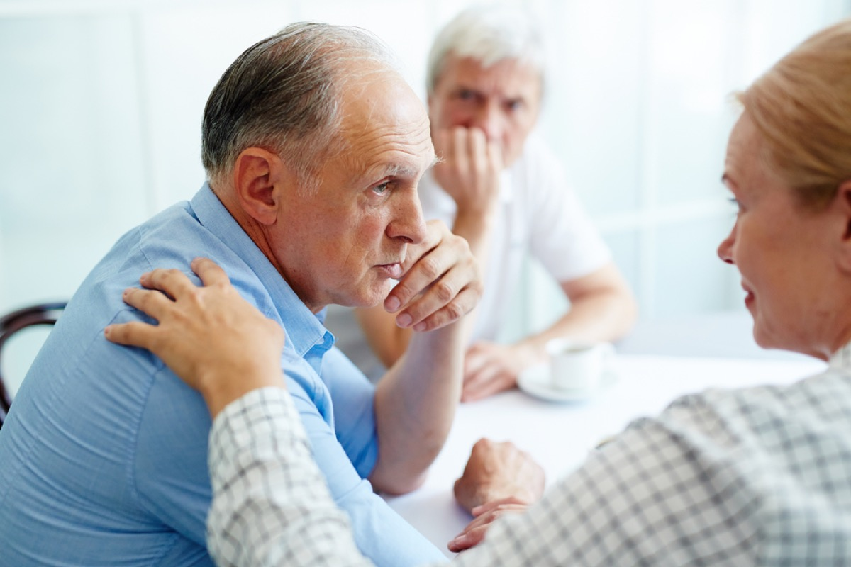 older couple arguing at table, etiquette mistakes