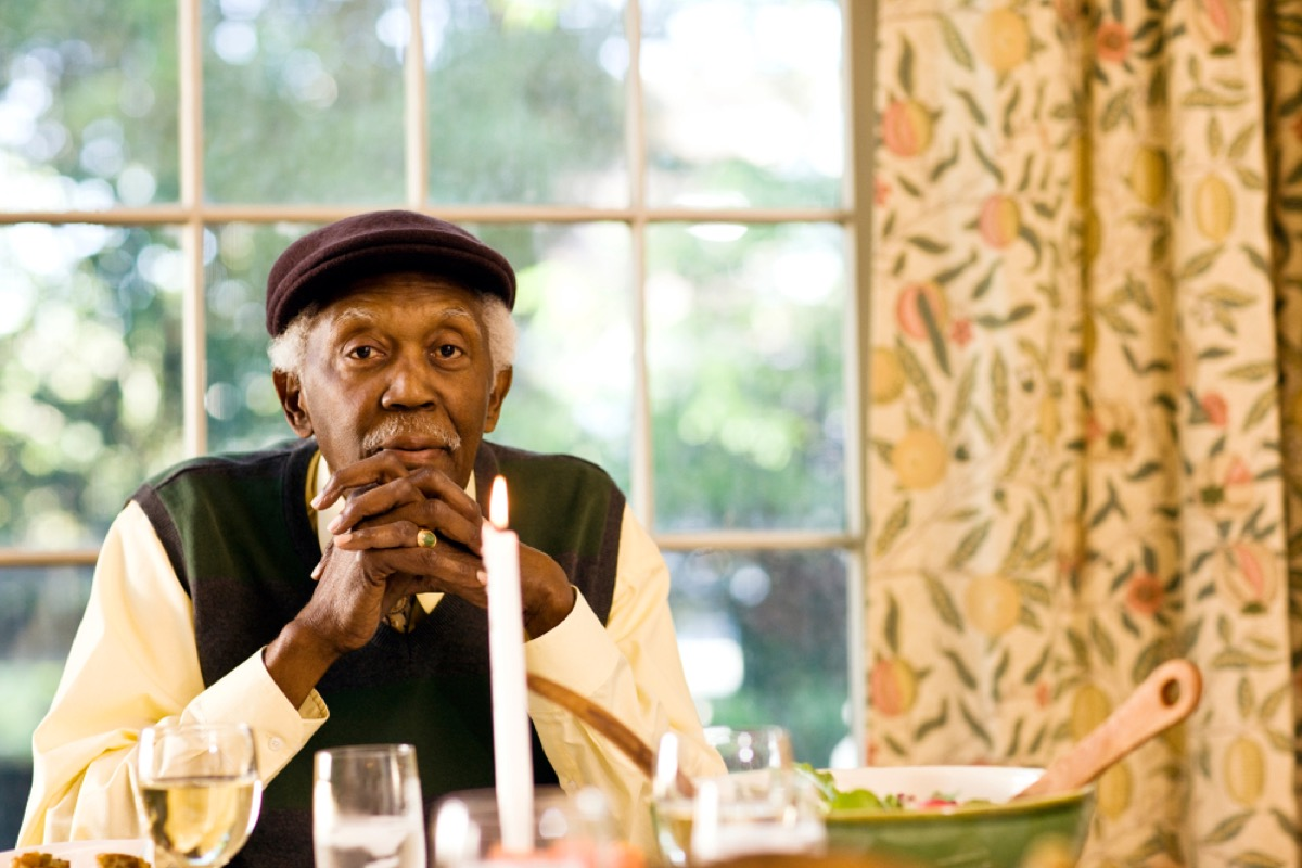older man with elbows on the dinner table, etiquette mistakes