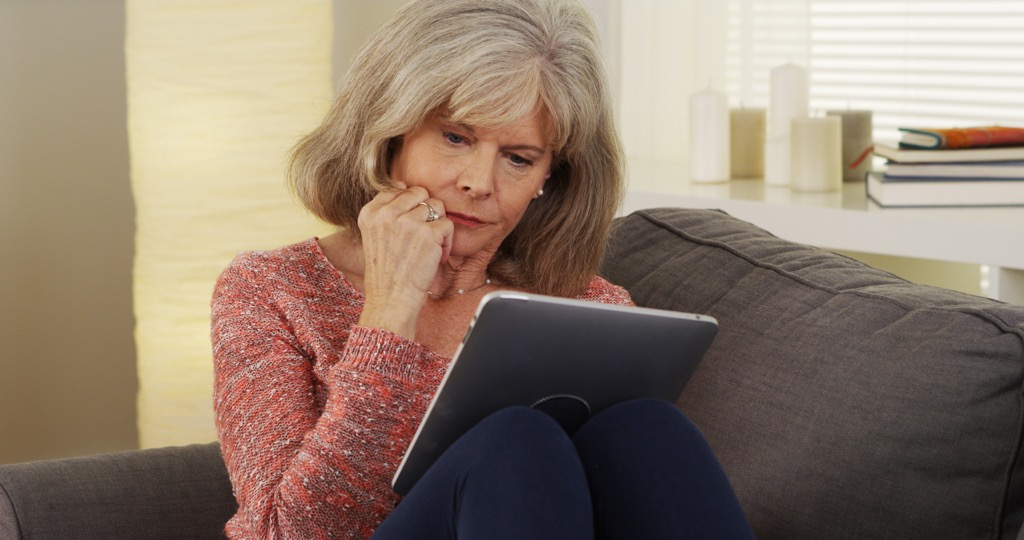 older person on ipad