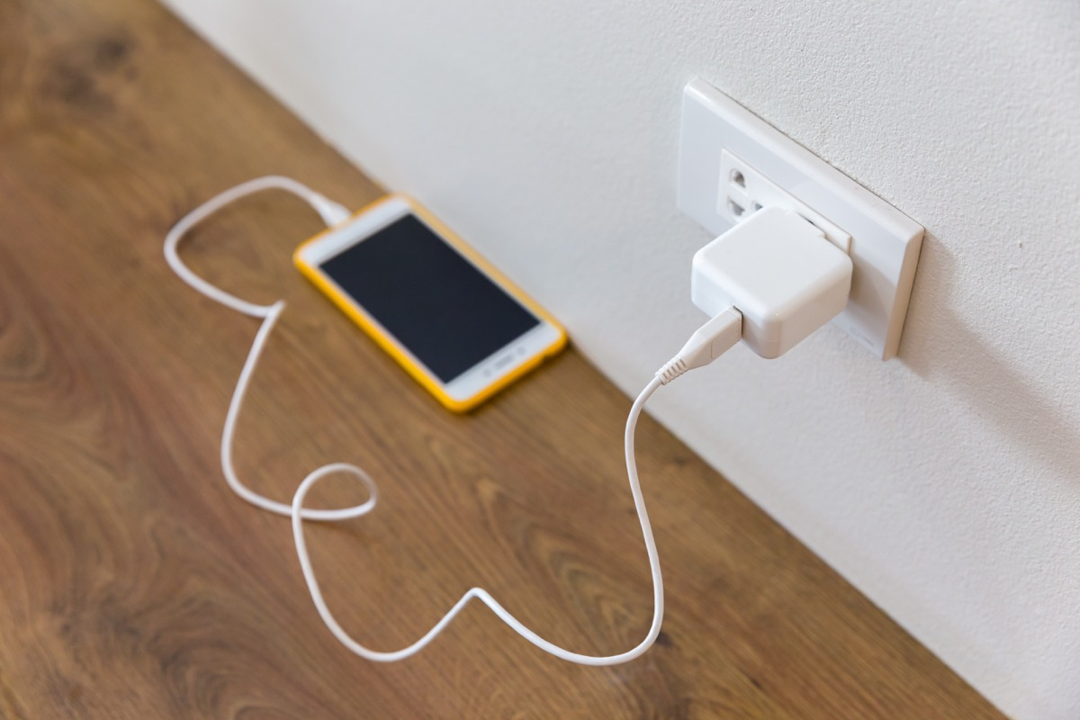Smartphone sitting in a charger