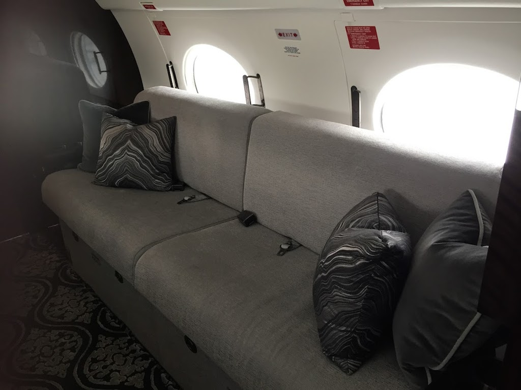 couch in private jet, photo by Diana Bruk.