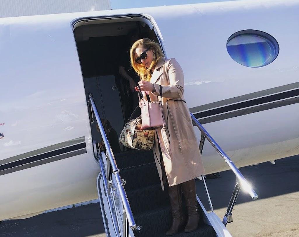 Diana Bruk boards private jet at Teterboro Airport.